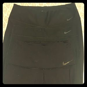 Three pairs of Nike leggings , sizes are different